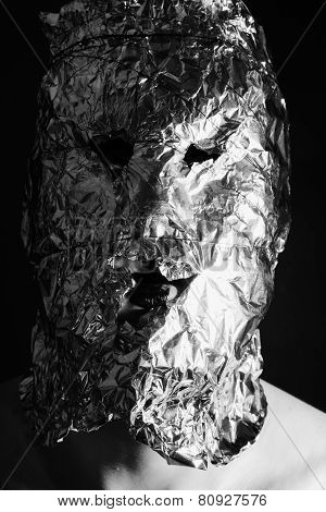 Portrait Of A Man Dressed In Scary Masks Foil
