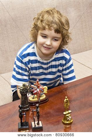 Boy Playing With Toy Knights