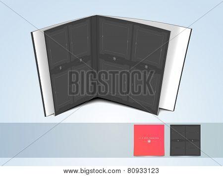 Blank open album on shiny light sky blue background.