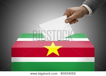 Ballot Box Painted Into National Flag Colors - Republic Of Suriname