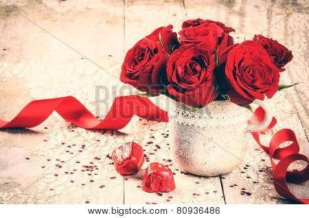 Valentine's Setting With Bouquet Of Red Roses And Chocolate
