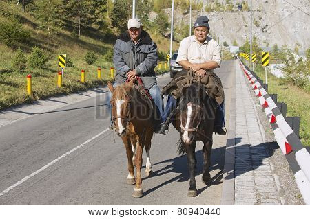 Men ride on horseback in Almaty, Kazakhstan.