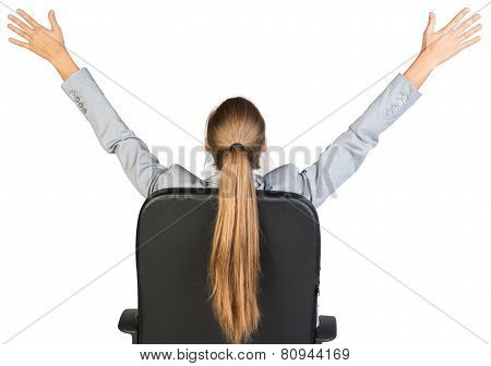 Businesswoman on office chair stretching her arms