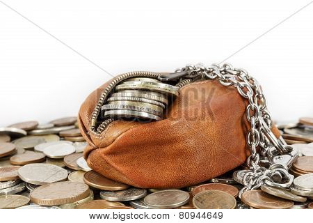 Coin purse on pile of coins