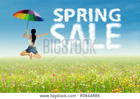 Girl Jumping Beside Spring Sale Clouds