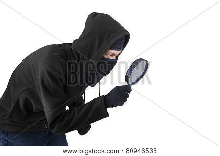 Man Using Magnifying Glass For Spying