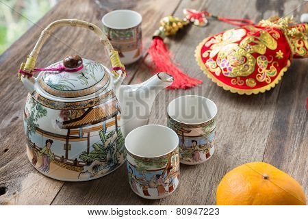 Antique Chinese Tea Set On Wooden Table