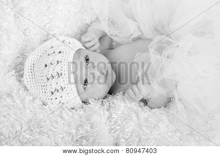 Baby Girl In A White Hat Wearing A White Tutu