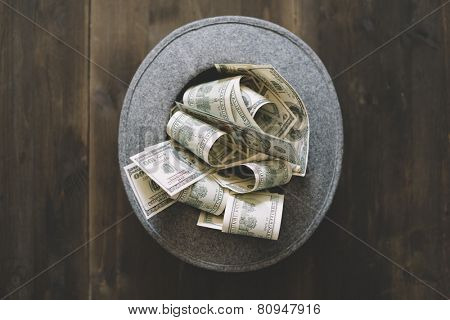 money and the wool hat on the wooden background,selective focus
