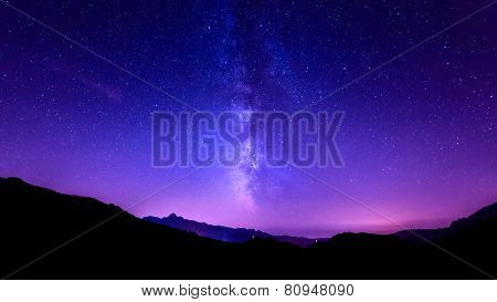 Milky Way on night Sky Stars. Purple sky