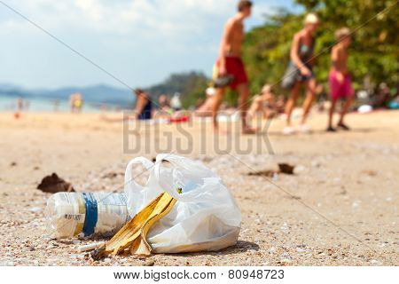Garbage On A Beach Left By Tourists, Environmental Pollution Concept Picture.