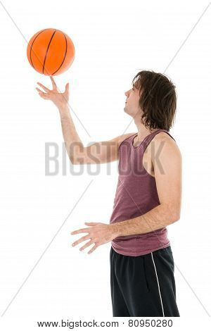 Young Man With Spinning Basketball At His Forefinger