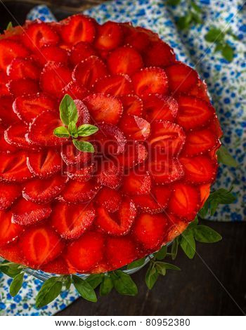 Tart with strawberries and whipped cream decorated