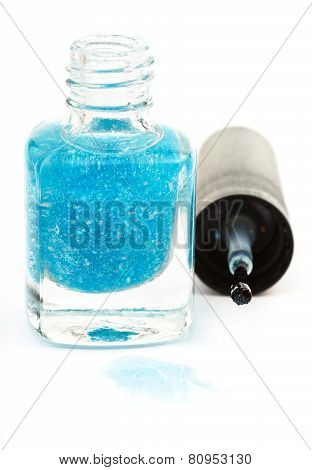 Bottle With Spilled Turquoise Nail Polish On White