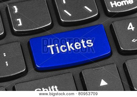 Computer notebook keyboard with Tickets key - technology background