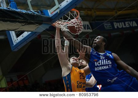 VALENCIA, SPAIN - JANUARY 21: Loncar with ball and Cooper 20 during Eurocup match between Valencia Basket Club and CSU Asesoft at Fonteta Stadium on January 21, 2015 in Valencia, Spain