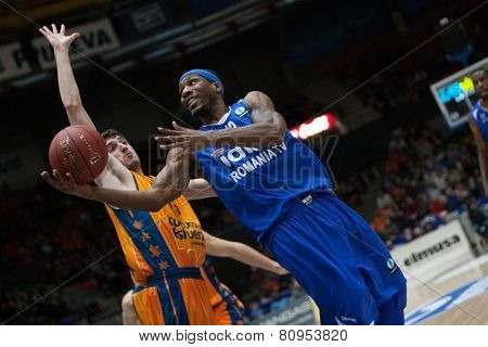 VALENCIA, SPAIN - JANUARY 21: Mohammed with ball and Vives during Eurocup match between Valencia Basket Club and CSU Asesoft at Fonteta Stadium on January 21, 2015 in Valencia, Spain