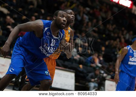 VALENCIA, SPAIN - JANUARY 21: Cooper 20 and Sato during Eurocup match between Valencia Basket Club and CSU Asesoft at Fonteta Stadium on January 21, 2015 in Valencia, Spain