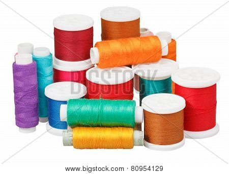 Various Thread Bobbins Isolated On White