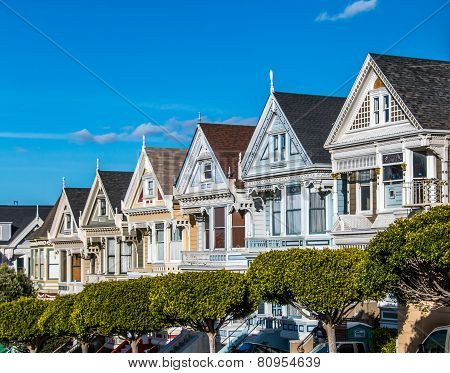 Victorian Houses in San Francisco on blue sky background