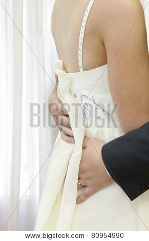 Bridegroom holding bride