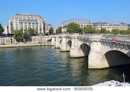 Pedestrians And Traffic On The Pont Neuf In Paris, France