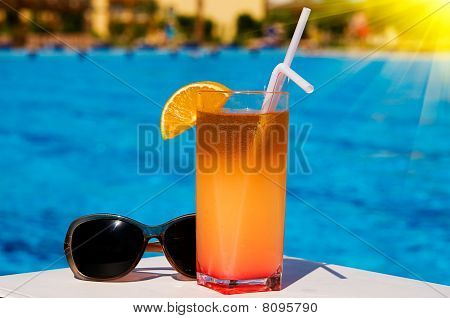 Glass Of Tasty Juice With Pipes And Sunglasses.