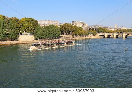 Tour Boat Near Pont Neuf And Ile De La Cite In Paris, France