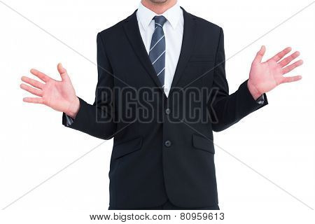 Well dressed businessman with hands up on white background
