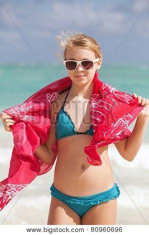 Portrait Of Beautiful Blond Teen Girl On Ocean Coast