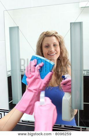 Glowing Woman Cleaning A Mirror
