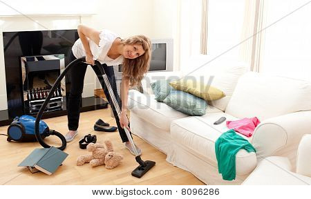 Enthusiastic Woman In Her Chaotic Living Room