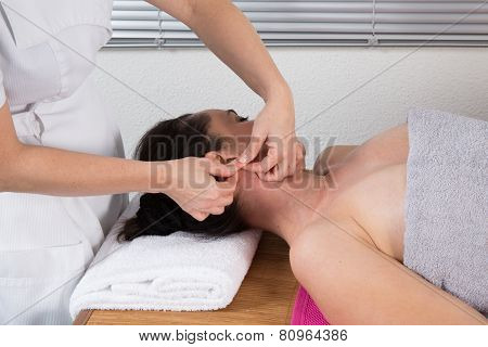 Therapist Woman Doing Massage On A Woman's Head