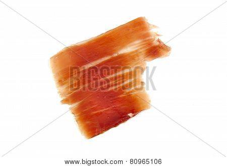 Spanish serrano ham slice isolated on white background.