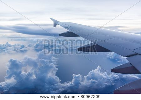 Aircraft Wing On The Clouds, Flying Evening Background