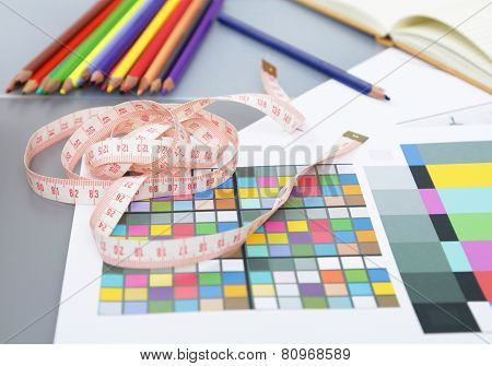 Designer's table with blank note and tools ,glasses