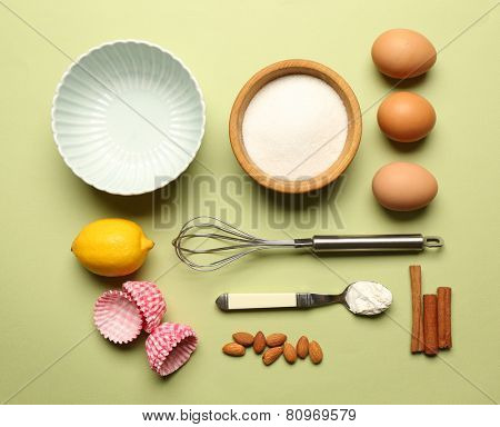 Food ingredients and kitchen utensils for cooking on green background