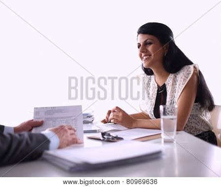 Customer and agent sitting at desk in a meeting or successful collaboration under businesspeople on