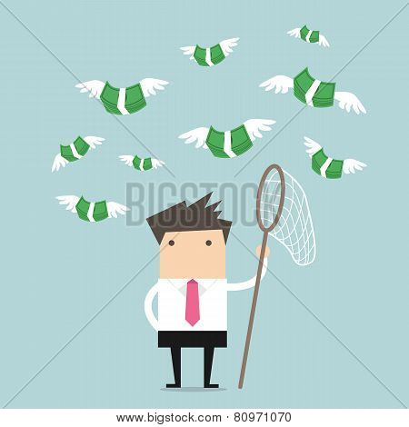 Concept businessman trying to catch money fly