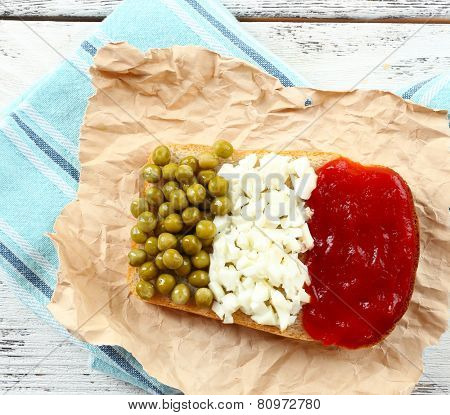 Sandwich with flag of Italy on table close-up