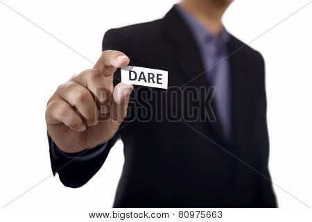 Hand Holding Paper With Dare Text