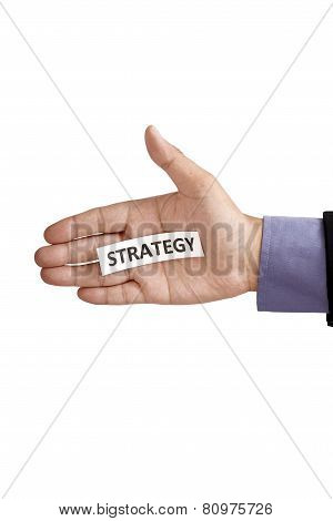 Hand Holding Paper With Strategy Text