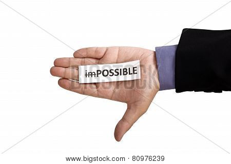 Hand Holding Paper With Impossible Text