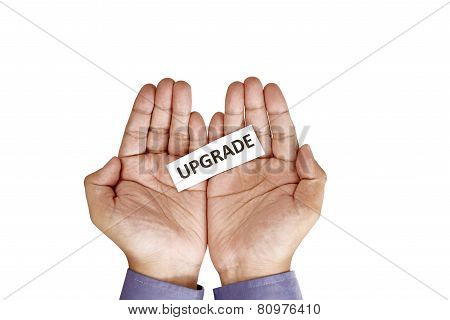 Hand Holding Paper With Upgrade Text
