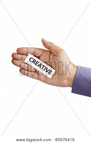 Hand Holding Paper With Creative Text