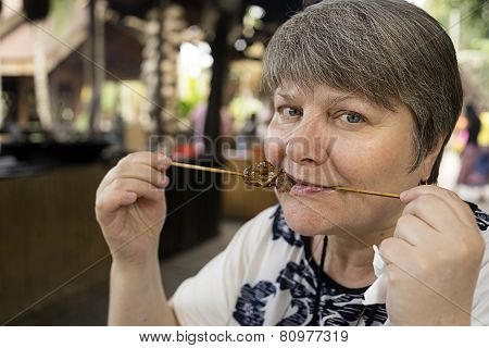 Woman eating a kebab Chinese sparrows