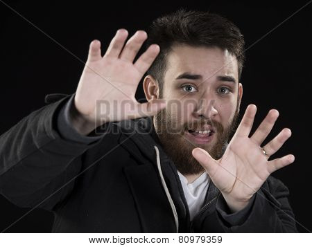 Afraid Young Man with Hands Up