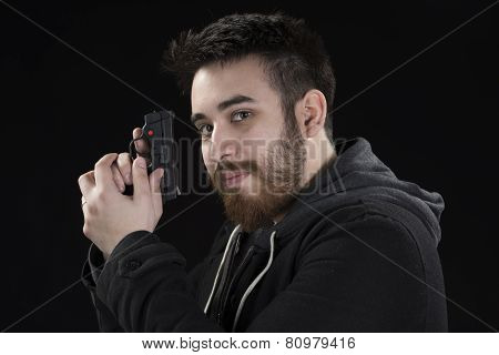 Goatee Young Man in Jacket Holding Small Gun