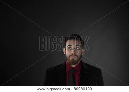 Goatee Man in Formal Wear Looking Up
