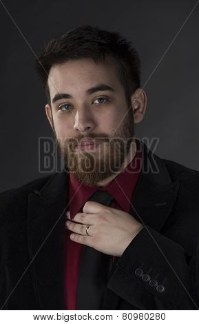 Gorgeous Man in Formal Wear Holding his Tie
